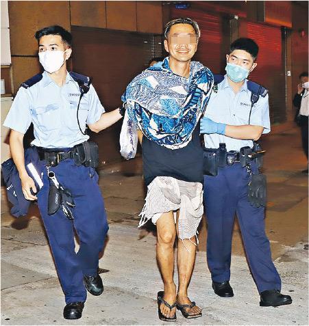 來自台灣的林姓畫家涉案被捕,他被捕時面露笑容。