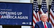 美國總統特朗普周一(27日)表示,「有很多方式」讓中國政府為疫情給美國和全世界造成的巨額損失承擔責任。圖為特朗普周一在白宮主持新聞發布會,熒幕上寫有「讓美國重啟」。(路透社)