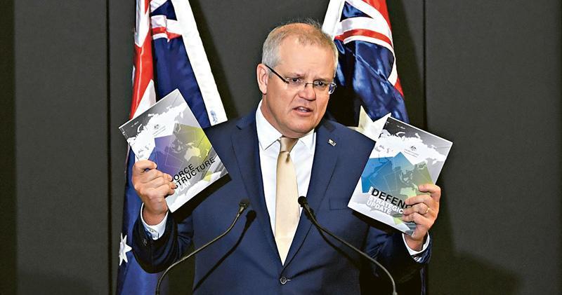 澳洲總理莫里森昨在堪培拉發表「2020年國防戰略更新」,宣布一系列強化長程攻擊以及網絡作戰能力等方針。(路透社)