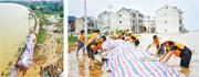 江西鄱陽湖區水位已超越1998年洪災的水平,且可能會進一步上升,目前當地已啟動最高級別的一級響應,而各方也在加緊防範可能到來的大洪水。在鄱陽縣鄱陽鎮江家嶺村,村民和武警官兵在堤壩上給防水牆鋪設防水布,防止河水侵蝕牆體。(新華社)