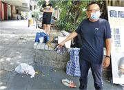 譚得志(右)於黃大仙下邨設街站,有市民與其支持者口角,其後有人高空擲物。(人民力量提供)