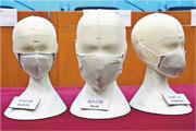 政府計劃於9月再向市民派發「銅芯抗疫口罩」。消息人士表示,新一輪的口罩為第一輪派發剩餘的「貨尾」,參考到現時坊間口罩供應穩定,政府暫未計劃再訂製新一批銅芯口罩。(資料圖片)