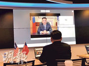 國民黨主席江啟臣(熒幕中)周一以視像形式參加「美台國防工業會議」,表示「親美和陸」可並行不悖。(中央社)