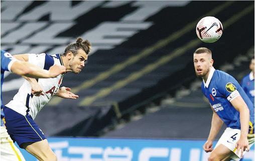 加里夫巴利(左)昨後備入替一「槌」定音,為熱刺奠勝兼攻入重返英超後的首個入球。(Getty Images)