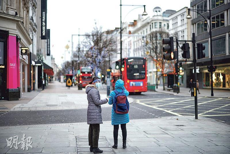 聖誕節翌日,抗疫封城下的英國倫敦市面冷清。(路透社)