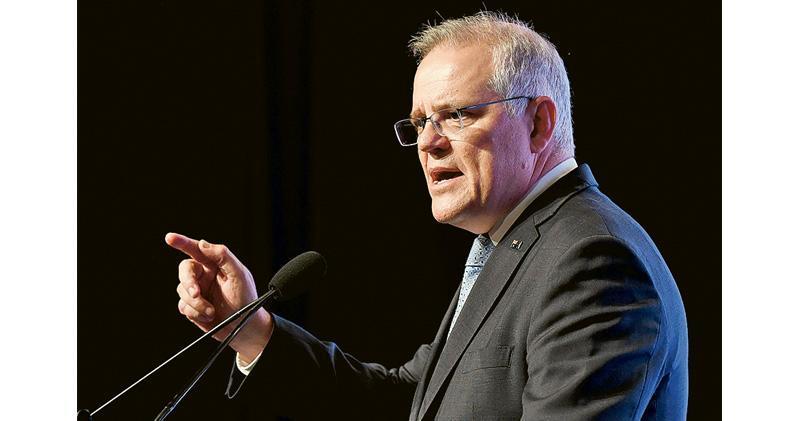 澳洲總理莫里森6日接受墨爾本3AW電台訪問時表明,一旦台海爆發戰爭,澳洲將會履行支援美國及印太地區盟友的承諾。圖為莫里森6日在墨爾本出席活動時講話。(法新社)