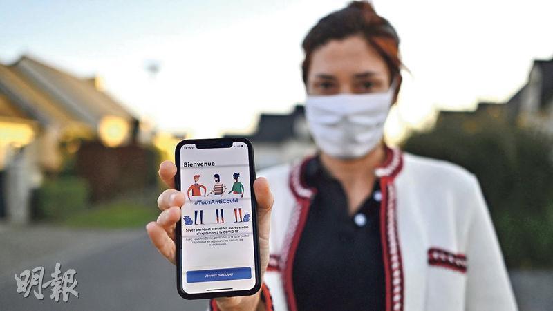 法國現有防疫軟件「TousAntiCovid」,協助當局在有需要時追蹤新冠患者。(法新社)